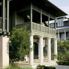 Tuscan columns of heavy concrete ground the otherwise breezy beach house. Architect Bill Ingram Columns in the same colour as the house walls not the woodwork Classic Architecture, Facade Architecture, Tuscan Column, Bill Ingram, Green Siding, British Colonial, Tropical Houses, Coastal Homes, Gay Pride