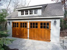 Carriage Lights for Garage | Wood carriage garage doors with glass lights.