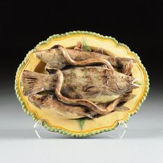 A MAFRA PALLISY WARE MAJOLICA CHARGER, CALDAS, too much damage to bid, though