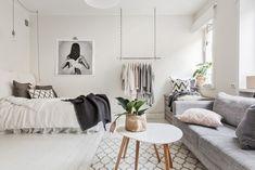 Jurnal de design interior: Amenajare în alb și gri într-o garsonieră de 35 m²