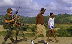 U.S. troops escorting suspected members of the People's Revolutionary Army of Grenada, 1983
