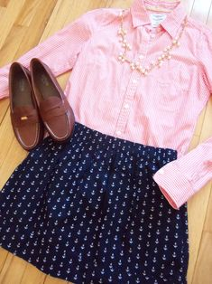 Maybe with heels... Pink striped button down. Navy skirt with anchor pattern. White and gold necklace.