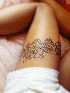 romantic garter tattoo