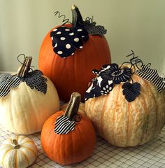 10 Boo-tiful DIY Pumpkins. Pumpkins with fabric leaves #diy #pumpkins #fall