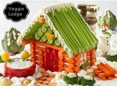 Dazzle your family and friends with this fantastic Veggie Lodge.  It's almost too cute to eat.  Check out  the Snowman Cheese Ball and Tomato Tulips as well!