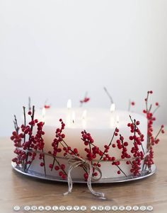 candle and red berries