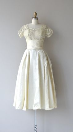 Vintage late 1940s, early 1950s cream silk wedding gown with lace upper bodice and sleeves, wide pleated cummerbund waist, full skirt and metal back