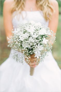white bridal bouquet with babys breath #bouquet #babysbreath #weddingchicks http://www.weddingchicks.com/2014/02/20/casual-elegance-wedding-for-under-7k/