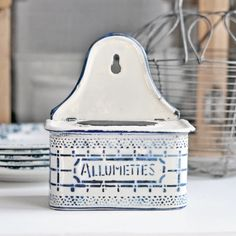 An early 1900s French enamelware matchbox