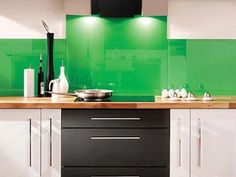 2014 House Design Trends   Home + Garden   PureWow National  I love the Tempered-Glass Backsplash and the bright green color. Simple, Modern, clean while adding pop of color