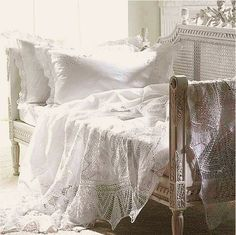 Bench with pillows and crochet blankets. #white