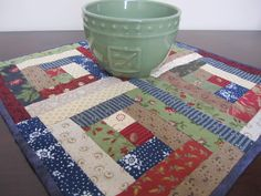 Log Cabin Block Quilted Table Runner, Candle Mat, Handmade Small Mini Quilt, Table Topper. $25.00, via Etsy.
