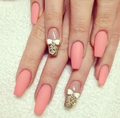 Matte coral nailpolish with an accent gold nail.