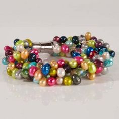 Pearl & Crystal Bracelet - Like the Pearl and Crystal Necklace, color and life collide in the Pearl and Crystal Bracelet.   Substantial enough to wear on its own, this bracelet features a strong magnetic clasp that makes it easy to grab, snap and go