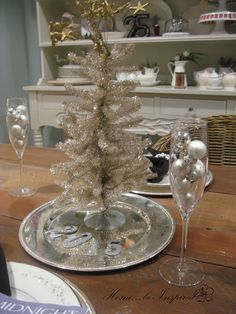 My little tinsel tree with ornaments in Champagne glasses from World Market