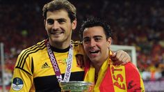 #realmadridbarcelona - Iker #Casillas & #Xavi Hernández (Spain)  Iker Casillas (L) and Xavi Hernández of Spain celebrate with the trophy after victory in the UEFA EURO 2012 final against Italy