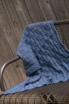 Precious Little Cables Baby Blanket - This beautiful baby blanket showcases a wonderful cable pattern. Although the cables span the entirety of the blanket, this blanket is straightforward to make and is perfect for intermediate knitters. from the October 2015 issue of I Like Knitting