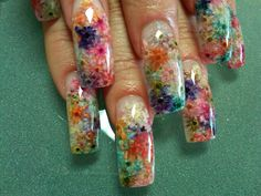 Real dried flowers with a clear acrylic overlay topped with clear gel polish
