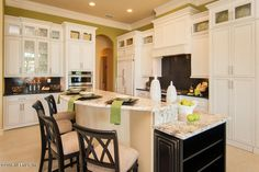 Traditional Kitchen with Breakfast bar, Glass panel, L-shaped, Complex granite counters, Custom hood, Crown molding, Slate