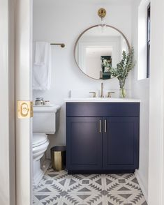 Modern bathroom with navy blue vanity, gold accents, and patterned cement tile. Blue Bathroom Vanity, Navy Blue Bathrooms, Powder Room Vanity, Blue Vanity, Guest Bathrooms, Downstairs Bathroom, Bathroom Layout, Bathroom Ideas, Bathroom Designs