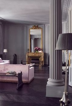 """image of Florence Baudoux's Paris Apartment on cover of book, """"New Paris Style"""". image via Habitually Chic blog. ALL MOLDING PAINTED SAME COLOR--inspiration for living room paint."""