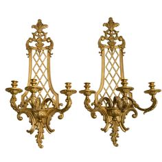 View this item and discover similar for sale at - An imposing and majestic pair of gilt bronze French Regence style wall sconces. With trellis design backplate and scrolling acanthus leaves, each arm is Victorian Lighting, Antique Lighting, Candle Wall Sconces, Wall Sconce Lighting, French Walls, Wood Framed Mirror, Trellis Design, Buffet Lamps, Modern Wall Lights