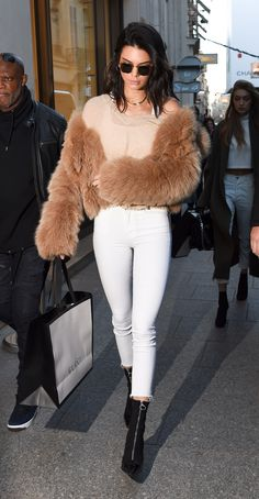 November 18, 2016 In a caramel fur coat, beige sweater, white tank top, white skinny jeans, zip-up sock boots and sunglasses while out in Paris.