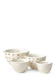 Add style to your kitchen utensils with these adorable gold polka-dot measuring cups!