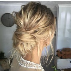 This low twisted bun is what textured hair dreams are made of! We are loving the lived-in yet elegant feel. Create separation in hair before starting any style you want to add texture to by spraying Style Sexy Hair Play