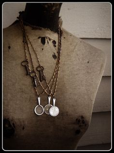 Watson and Holmes -  Case No. 4 necklace.  Vintage Monocle and skeleton keys in a  steampunk look. Can you solve the mystery? by Chymiera  at  Etsy.