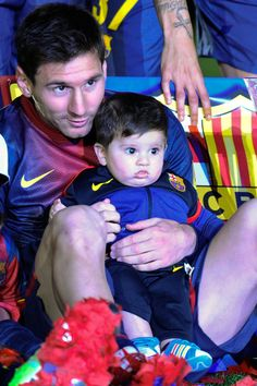Lionel Messi of FC Brcelona holds his son Thiago during the celebration after winning the Spanish League, after the La Liga match between FC Barcelona and Real Valldolid CF at Camp Nou on May 9, 2013 in Barcel;ona, Spain