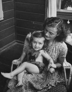 Gretel Braun Fegelein, sister of Eva Braun holding her daughter Eva Fegelein - 1947. Eva committed suicide when her boyfriend was killed in an auto accident. Eva's father had been shot for desertion when Hitler found out Himmler was going to surrender to the Allies.