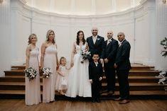 Wedding party in neutral pinks and dark blues. The bride is wearing Gavin by #SotteroandMidgley. #Midgleybride #ballgowns #satinweddingdress #satingown #glamorous #weddingparty