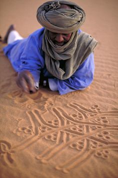 Algeria. Bedouin drawing Three Gazelles in the sand.