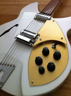 White + Gold Rickenbacker 12