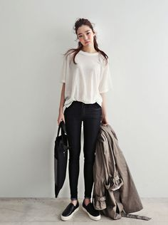 Simple summer look -- stretchy black jeans, sleek slip-ons sneakers, oversized white t-shirt, dove-colored trench. Neutral/graphic colors make all of it look elegant even though it's mostly casual.
