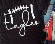 Eagles Football SVG football mom svg design football shirt | Etsy Christmas Tree Cutting, Christmas Svg, Football Shirt Designs, Football Shirts, Embroidery Files, Mom Shirts, Sports Shirts, Eagles, Cutting Files