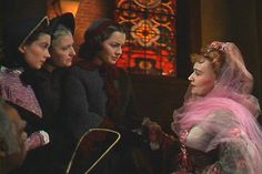 Money for the War: Scarlett, Mrs. Mead and Melanie accept a donation from Belle Watling
