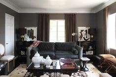 dark gray living room. My curtains are a tan and my furniture a tan suede. I can picture it with this color