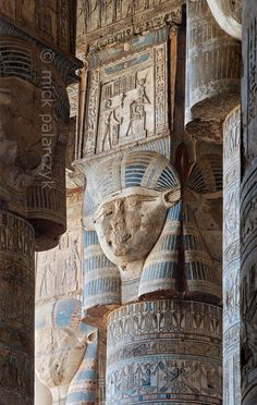 """[EGYPT 29516] 'Hathor headed columns in Dendera.'  The columns in the outer hypostyle hall (or pronaos) of the Hathor Temple at Dendera are crowned by four-sided capitals carved with the face of the cow-eared goddess. The faces symbolize the four cardinal points of the universe and stress the universal character of the sky goddess Hathor, who was also called """"Lady with the four Faces"""". The square structure that is placed on top of the actual face is a sistrum, a ritual musical instrumen..."""