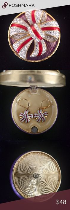 VTG Joan Rivers 3pc set VTG signature Joan Rivers trinket box with bow brooch detachable, pair bow design earrings both in Svarowski Crystal and red enamel design, box in purple tone and gold. Small color fault on box, see picture, all in great vintage condition, always sold as is Joan Rivers Jewelry Brooches