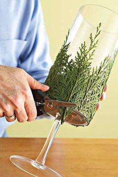 This DIY Evergreen Candle Will Make Your Holidays Even Brighter - - Take a pretty glass container, glue bits of greenery around it, and set candles inside to combine the freshness of greenery with the welcoming warmth of candlelight. Rustic Christmas, Winter Christmas, All Things Christmas, Christmas Home, Christmas Wreaths, Diy Christmas Wedding, Half Christmas, Christmas Garden, Christmas Mason Jars