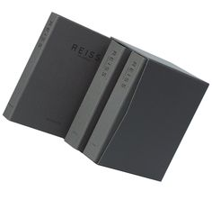 Title:      Cloth covered slipcase  Client:      Reiss  Materials:      Book cloth, grey board  Processes:      Foil block, hand cover