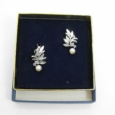 Avon Gloriana Clip Earrings Leaves Pearl Drop Dangle Silver Plated  | eBay Gold Drop Earrings, Clip Earrings, Feather Earrings, Teardrop Earrings, Sterling Silver Earrings, Vintage Earrings, Vintage Jewelry, Vintage Avon, Unique Vintage