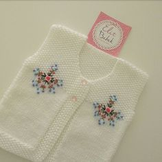 Beautiful baby vest with embroidered yokes Baby Knitting Patterns, Knitting Designs, Crochet Patterns, Crochet Baby Cocoon, Kurti Embroidery Design, Baby Pullover, Dear Mom, Baby Vest, Knitted Baby Blankets