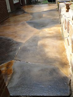 "Cracked patio concrete stain - Existing cracks as ""mortar lines"" to create the appearance of large stones."