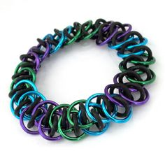Peacock inspired stretchy chain mail bracelet by TattooedAndChained on Etsy, $20.00