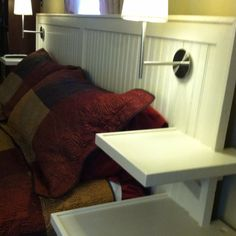 DIY headboard with built in lights, floating nightstands, and electrical outlets under the bottom shelf.