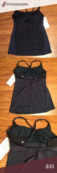 ↡$28  NEW!! ❌FINAL PRICE DROP❌ LULULEMON yeah yoga NEW!! LULULEMON yeah yoga tank -NEW condition!! -navy color -tag has been detached ☹️ -cups are included  PRICE FIRM ORIGINAL LISTING PRICE: $35 lululemon athletica Tops Tank Tops