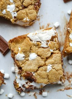 A gooey s'more that is transformed into a cookie bar. Graham Cracker cookie, chocolate and marshmallow fluff make for the perfect crunchy and gooey bar.